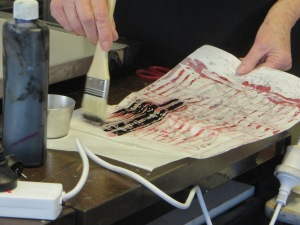 applying ink to waxed paper