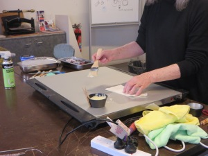 applying wax to fine paper