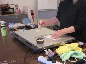 applying wax to fine paper